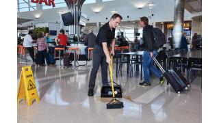 2018807-rcp-cleaning-maximizer-double-sided-broom-squeegee-travel-and-entertainment-food-court-talent-in-use.tif