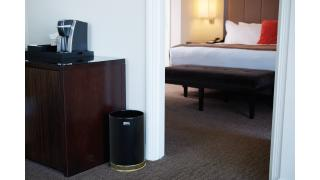 FGUB190010BK-rcp-decorative-refuse-steel-receptacles-black-hospitality-guest-room-in-use.tif