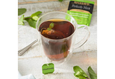 Glass mug of Perfectly Mint Tea with tea bag and foil packet