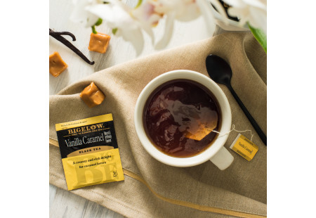 Lifestyle image of a cup of Bigelow Vanilla Caramel tea