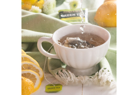 Lifestyle image of a cup of Bigelow Green Tea with Lemon