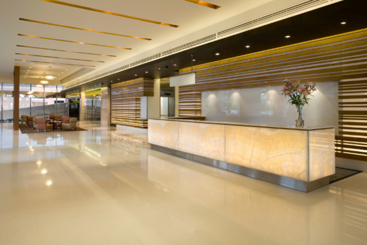 Hospitality setting with architectural fixture lighting