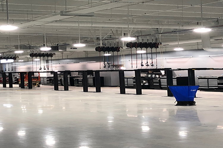 Retail auto dealership with integrated high bay lighting