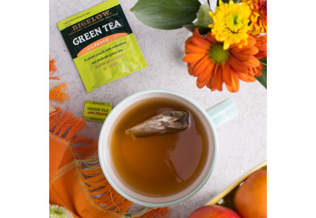 Lifestyle image of cup of Bigelow Green Tea with Peach