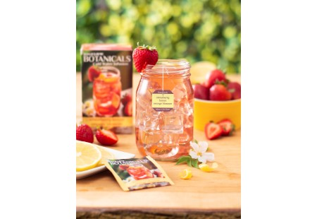 Mason jar filled with Strawberry Lemon Orange Blossom Cold Water Infusion with tea box and foil
