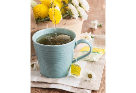 Lifestyle image cup of  Cozy Chamomile Herbal Tea