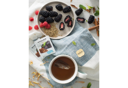 Lifestyle image of a cup of Bigelow Benefits Cinnamon and Blackberry Herbal Tea