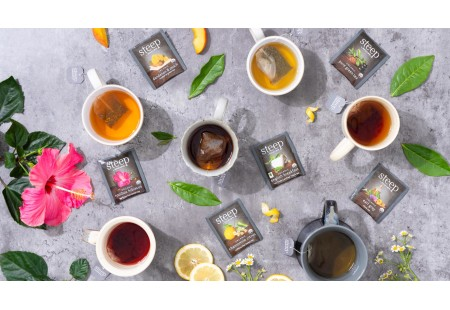 Cups of the Assortment of steep by Bigelow teas shwing ingredients