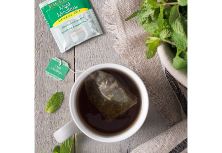 Lifestyle image of a cup of Bigelow Mint Medley Herbal Tea