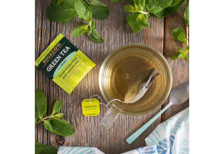 Lifestyle image of a cup of Bigelow Green Tea with Mint