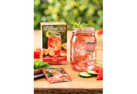 Mason jar filled with Watermelon Cucumber Mint Cold Water Infusion with tea box and foil
