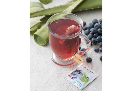 Lifestyle image of a cup of Bigelow Benefits Blueberry and Aloe Herbal Tea