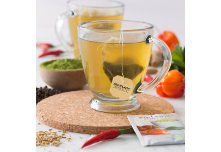 Lifestyle image of a cup Bigelow Benefits Tumeric Chili Matcha Green Tea