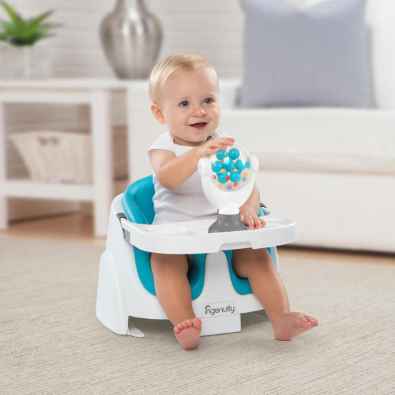 Spin-to-Engage™ Baby Base 2-in-1 Accessory Toy