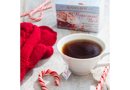 Lifestyle image of a cup of Peppermint Bark Herbal Tea