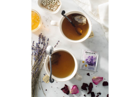 Lifestyle image of a cup of Bigelow Benefits Chamomile and Lavender Herbal Tea