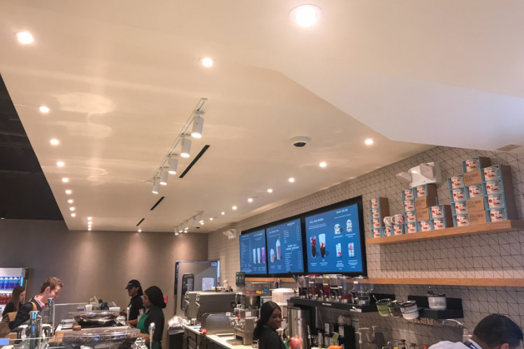 Menus brightly lit at a coffee shop