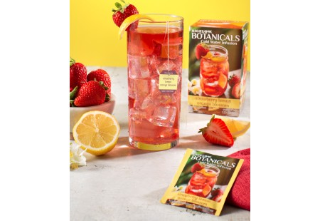 Glass of Strawberry Lemon Orange Blossom Cold Water Infusion with tea box and foil