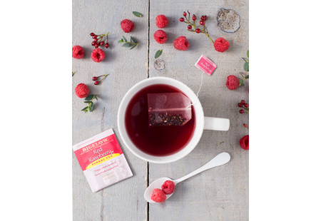 Lifestyle image of a cup of Red Raspberry Herbal Tea