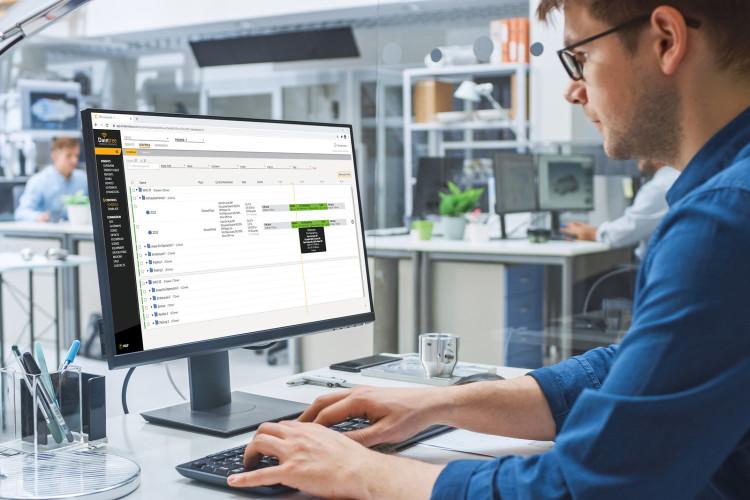 Young man at computer using Daintree Controls Software