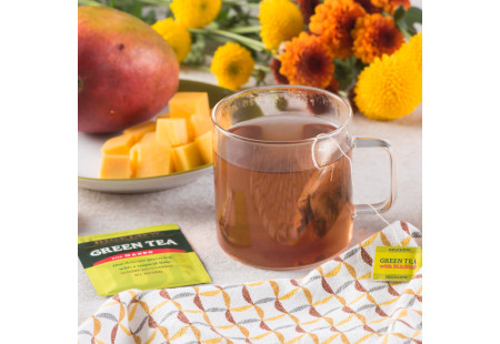 Lifestyle image of a cup of Bigelow Green Tea with Mango