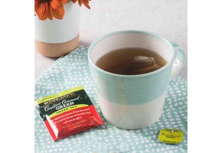 Lifestyle image of a cup on Bigelow Constant Comment Green Tea