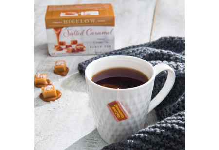 Lifestyle image of a cup of  Salted Caramel Tea