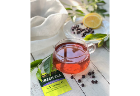 Glass cup of Green Tea with Elderberry plus Vitamin C and foil packet