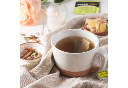 Lifestyle image of a cup of Bigelow Green Chai Green Tea