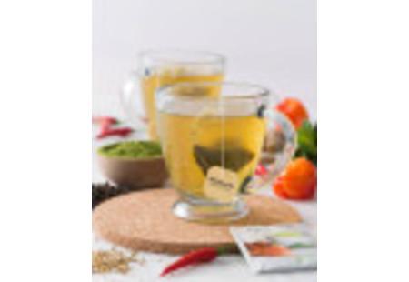 Lifestyle image of a cup Bigelow Benefits Tumeric Chili Matcha Green Tea