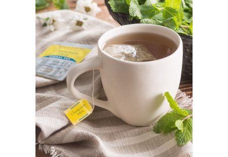 Lifestyle image of a cup of Chamomile Mint Herbal Tea